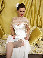 Glamorous brunette strips from her figure hugging satin evening dress increased by blue underclothes