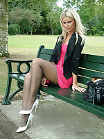 Blonde beauty Kathryn shows off her shapely long nylon legs and her pearl white stilettos