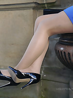 Sexy Tricia flashes say no to silky hanker nylon legs and shiny black high heels outdoors