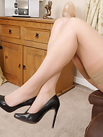 Hot leggy brunette Imelda parades her sexy legs in hammer away judicature wearing nylons and black high heel stilettos