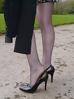Sexy Jenna shows off her amazing hooves in a pair of silky nylons and shiny black stiletto heels