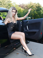 Gorgeous leggy kirmess Kathryn is behind the spin of a powerful Audi sport car, in enormous black auspicious pair of stiletto heels