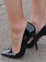 Hot blonde Milf Monica shows off her hot paws and shiny black stiletto heels