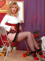 Angel as Paintress in black stockings and ankles