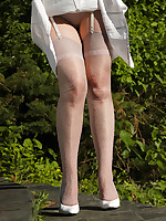 Angel in shiny silver colored stockings