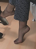Larissa`s shoe dangling and feet teasing in black sheer nylons