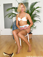 Leggy mature blonde in jeans dress and suntan vintage nylons