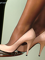 These creamy coloured high heels get this brunette nice and wet