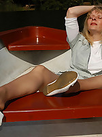 Angel on a boat in suntan pantyhose