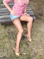Leggy babe posing outdoor in mini and seamed brown nylons