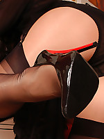 Angel in shiny suntans and black stockings