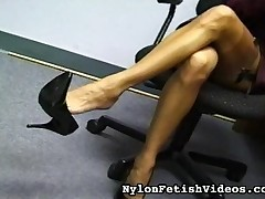 Sitting in her office, talking on the phone, dangling her shoe off her toe, speaking of her stockings to her friend.  She knows that men love stockings.  She knows men and what they like.  Watch her play with her legs as she shows us her garters, always dangling that shoe.Still has to work for a few more hours, but cant wait to get home to her other activities.  Legs up on the desk, playing her feet against each other.  Crossing and uncrossing.  What will she let us see?  She knows she has soft feet and she tells her friend all about her feet and toes.  The stockings take some wrinkles as she gets back to work.