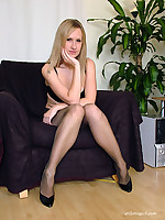 Horny blonde with a cute tattoo wearing some lovely pantyhose