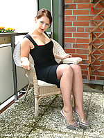 Pretty babe stripping dress on balkony in grey seamed nylons