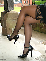 Melanie is outdoors showing off her nylon covered legs and sexy high heels