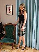 Sexy women in grey heels and a cheeky tartan dress