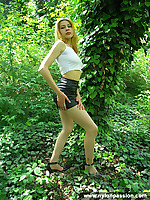 Blonde teen girl shows pantyhose in the forest