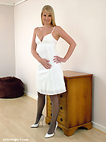 Hot blonde wearing white high heels and black stockings