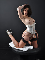 A sexy white corset covers this sexy babe and her gorgeous curves
