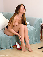 Gorgeous brunette slowly stripping and showing her sexy nylons
