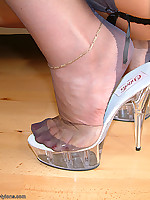 Leggy blonde teasing in high heels and grey seamed nylons