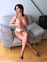 Busty secretary stripping in nude vintage stockings after work