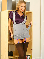Smart secretary Hayley-Marie in a purple shirt, grey minidress increased by chocolate stockings.