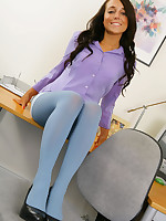 Beautiful brunette Bethany in a smart meeting outfit with blue pantyhose.