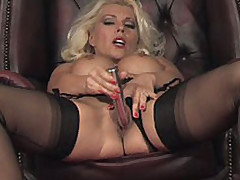 Beautiful Lana pleasures her sweet pussy with a shiny dildo