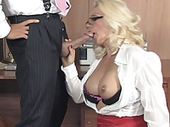 Lana gets on her knees and sucks some cock in the office