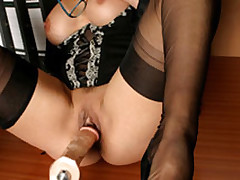 Lana the X office slut passes the time with her fuck machine