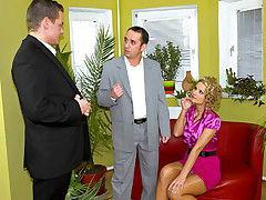 Two daring fellows banging a horny and clothed secretary