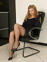 Long-legged Kathryn shows the brush gorgeous black nylon legs and tall shiny stilettos, as she struts around the assignation