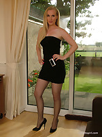 X housewife Toni is in a short sexy black dress with matching black stilettos