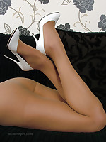 Leggy Eva shows off her sexy figure plus white lingerie plus high stiletto shoes