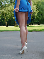 Elegant Naomi lifts up her sexy summer dress revealing her stunning long legs and white stilettos