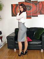 Hot brunette Carla shows off her lovely seamed nylons and shiny stilettos around the house, after a changeless day at the office