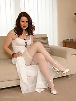Alison looks simply stunning and firsthand like in her matching white dress, stockings and high heels