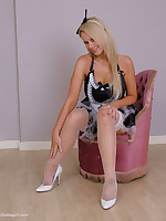Off colour Maid Larissa in fishnet stockings and white stiletto shoes