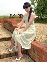 Scarlett our retro gal in vintage ff's, bullet bra and girdle..in someone's skin garden!