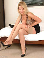 Blonde babe Rachel enjoys herself with two pairs of stiletto shoes one above her feet and the other in her mouth