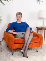 Holly shows ass almost 60s black nylons on high 60s easy chair!