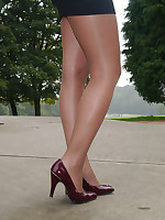 Amazing babe Faye shows off her amazing toes enervating a short skirt, nylons and a pair of tall stiletto heels