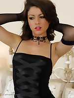 Glamorous brunette is simply irresistible in this saucy downcast binding time striptease.